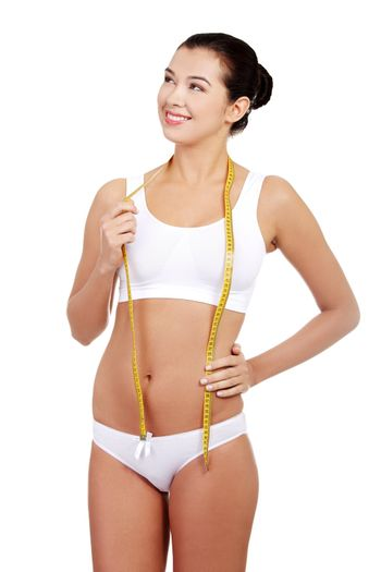 Pretty smiling woman with measurement type
