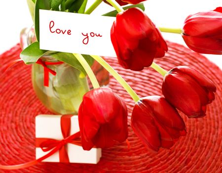 Red tulips with postcard