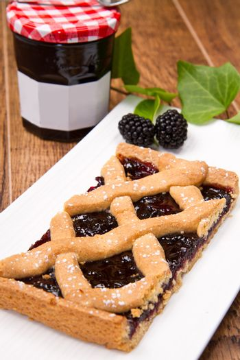 blackberry tarte on wooden table