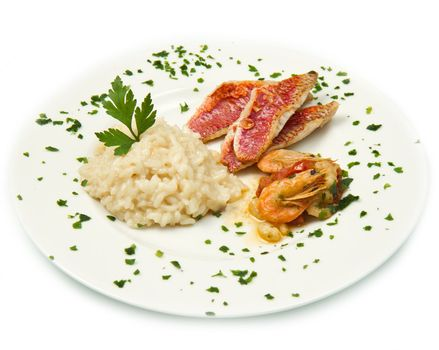 white dish with rice , red mullet fillets and seafood