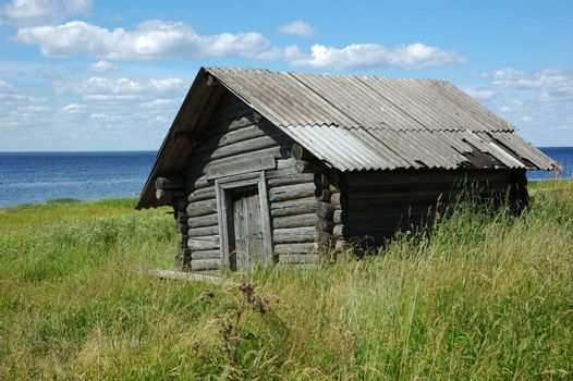 Old wooden shed on the lake bank, near Kargopol, north Russia