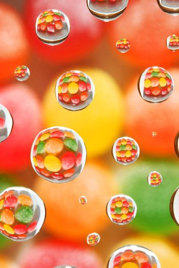 abstract background, selective focus on candy reflected in droplets