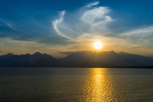 Lanscape of sunset over mountains and sea