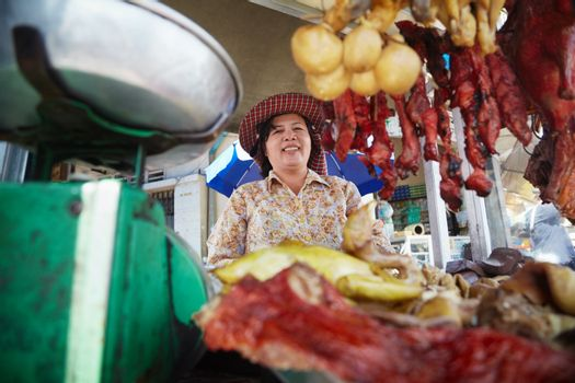 Portrait of Asian woman selling street food in Cambodia