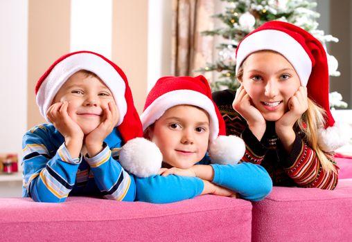 Christmas Children. Happy Little Kids wearing Santa's Hat
