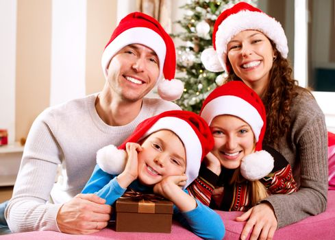 Christmas Family with Kids. Happy Smiling Parents and Children
