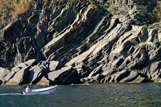 Motorboat near rocky shore -  Vernazza Italy