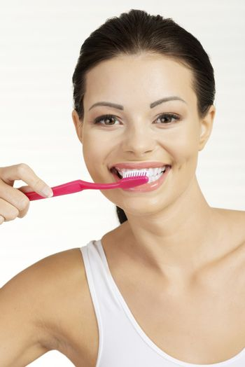 Woman with great teeth holding tooth brush