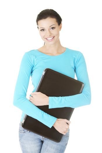 Young woman holding 17 inch laptop
