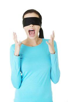 Beautiful frighten young blindfold woman screaming