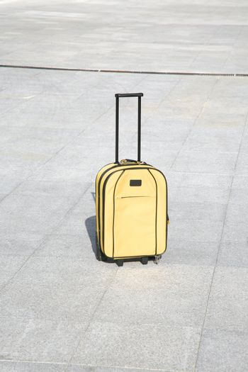 yellow suitcase alone