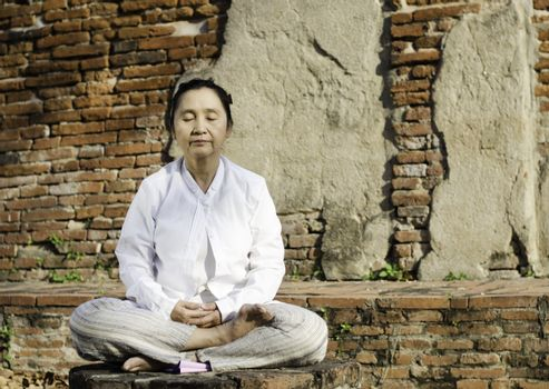 Buddhist woman in meditation