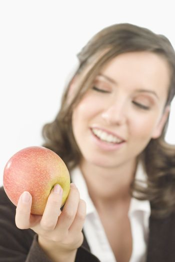 Young attractive woman presenting with an apple in her hand.