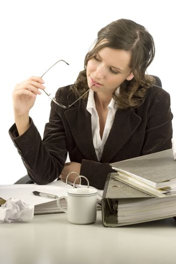 Young businesswoman sitting at a desk with folders