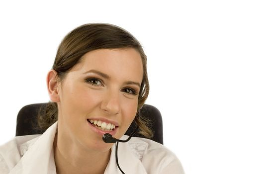 Beautiful smiling woman with headset isolated on white
