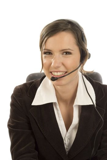 Attractive smiling woman with headset on white backgound