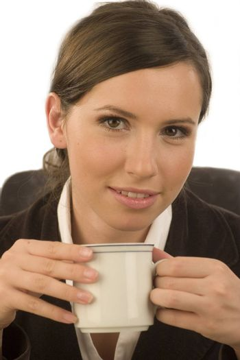 Young attractive businesswoman with a cup in her hand