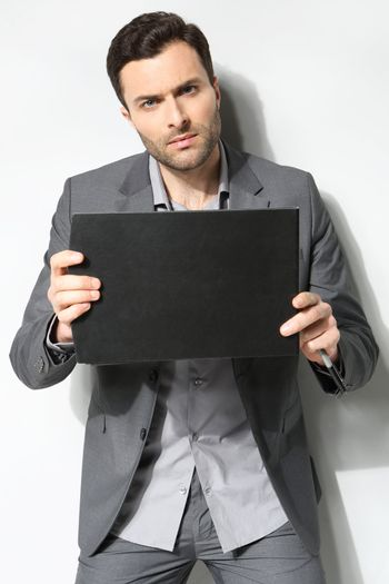 Portrait of a handsome business man ,Isolated on gray