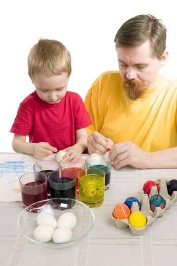 The man and the boy draw Easter eggs