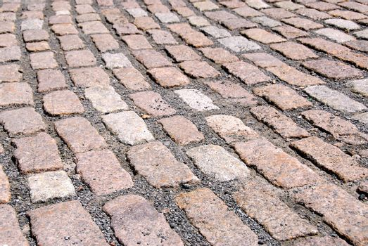Abstract background of old granite cobblestone pavement
