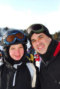 Portrait of a happy family on downhill ski resort