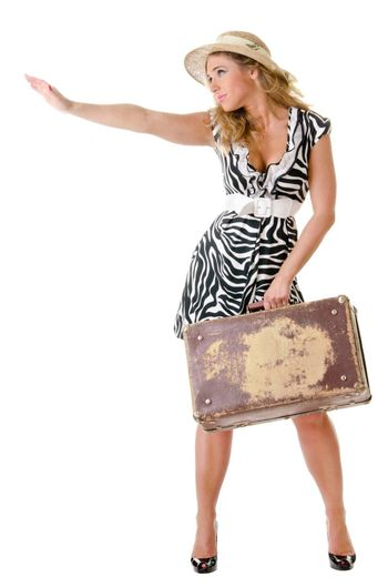 young woman dressed in retro style with an old suitcase