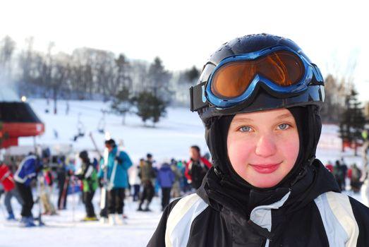 Portrait of a happy girl on downhill ski resort