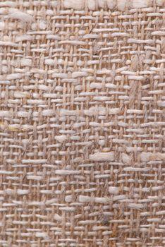 Closeup of a rustic linen fabric texture of natural color