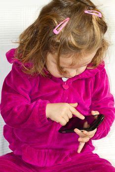 Baby speaks by phone.