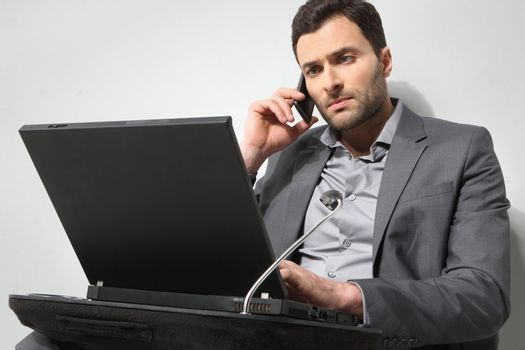 Young businessman working on is laptop