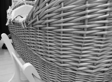 Monochrome of babies wicker crib on rocking stand