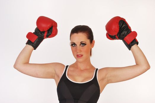 female boxer raising arms in triumph