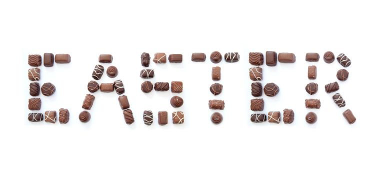 The word easter formed using chocolates over a white background