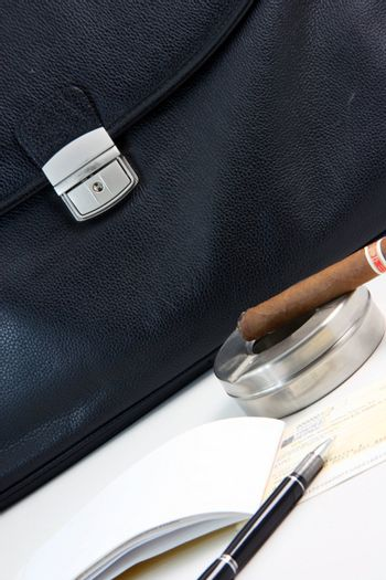 financial deal check writing cigar with black leather briefcase background praspective business concepts