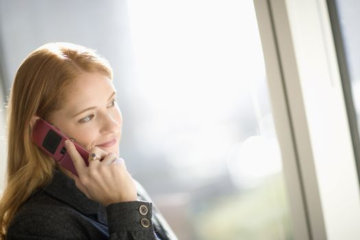 Young businesswoman talking on cell phone
