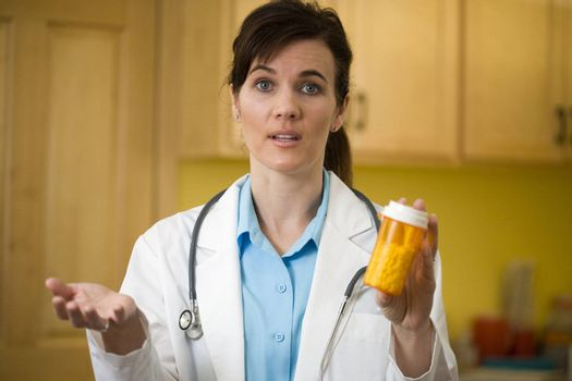 Woman doctor explaining prescription medication to the camera
