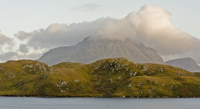 sea, hill and mountain in cloud. landscape in scotland