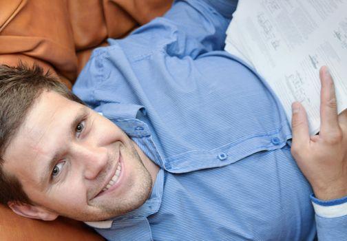Satisfied businessman smiling