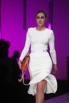 "ZAGREB, CROATIA - MARCH 13: Fashion model wears clothes made by Aleksandra Dojcinovic on ""PERWOLL FASHION.HR"" show on March 13, 2013 in Zagreb, Croatia."