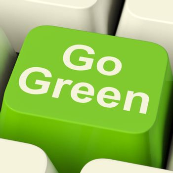 Go Green Computer Key Showing Recycling And Eco Friendliness