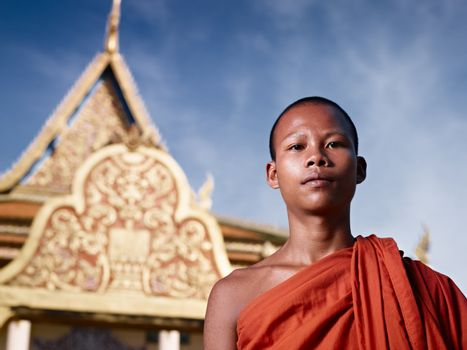 Portrait of buddhist monk near temple, Cambodia, Asia