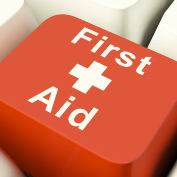 First Aid Computer Red Key Showing Emergency Medical Help