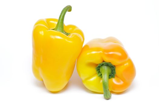 Two yellow bell peppers on white background