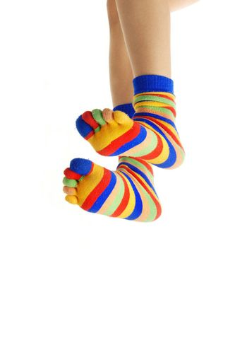 Close-up photo of jumpring human foots in zebrine socks