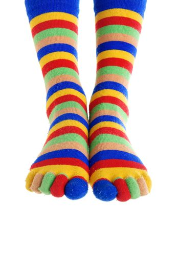 Close-up photo of two foots in the clown stockings