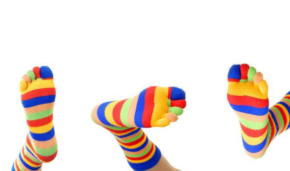 Close-up photo of three foots in colored zebrine socks