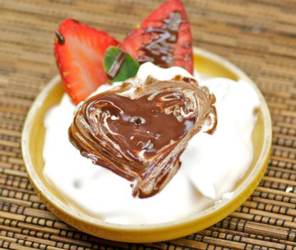 Delicious dessert with whipped crème and strawberry