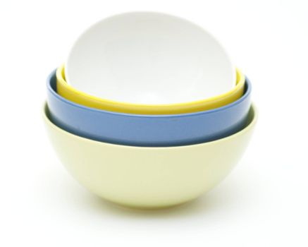 Green, blue, yellow and white plates on white background