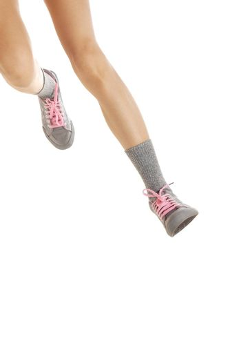 Close-up photo of the running and jumping legs of lady