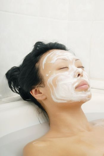 Sleeping woman with beauty mask in spa saloon